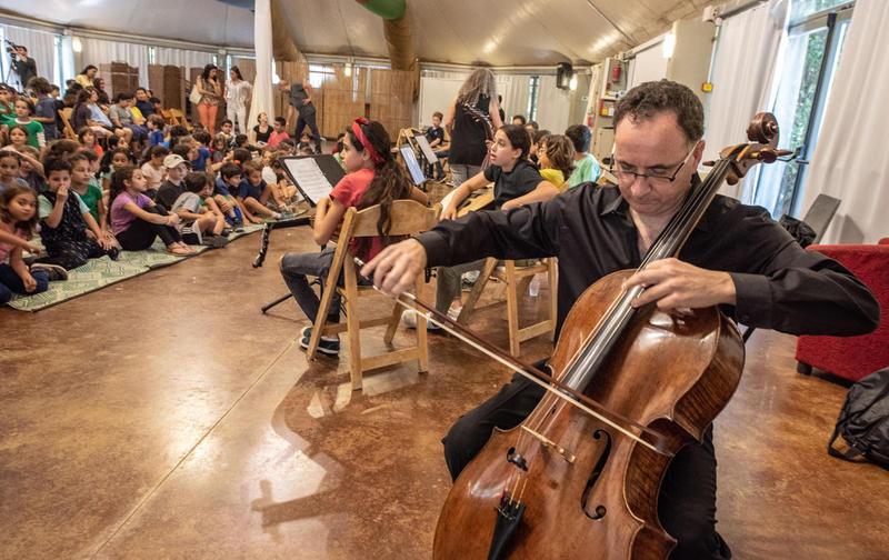Cellist Udi Bar-David at Neve Shalom/ Wahat al-Salam in Israel earlier this year