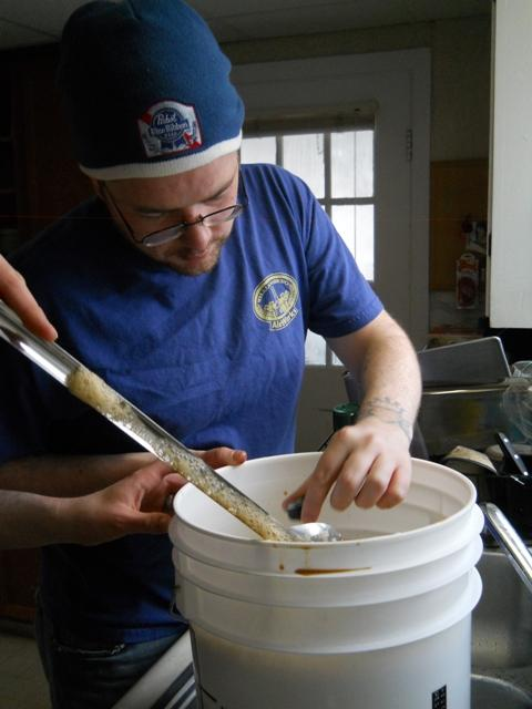 SCBC President Owen McLaughlan checks the temperature of a just-brewed stout.