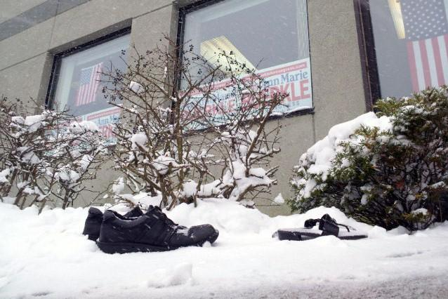 Shoes left by protestors sat in the snow outside Rep. Buerkle's campaign headquarters in Syracuse on Saturday. Protestors briefly tried to get inside the event, but were denied.