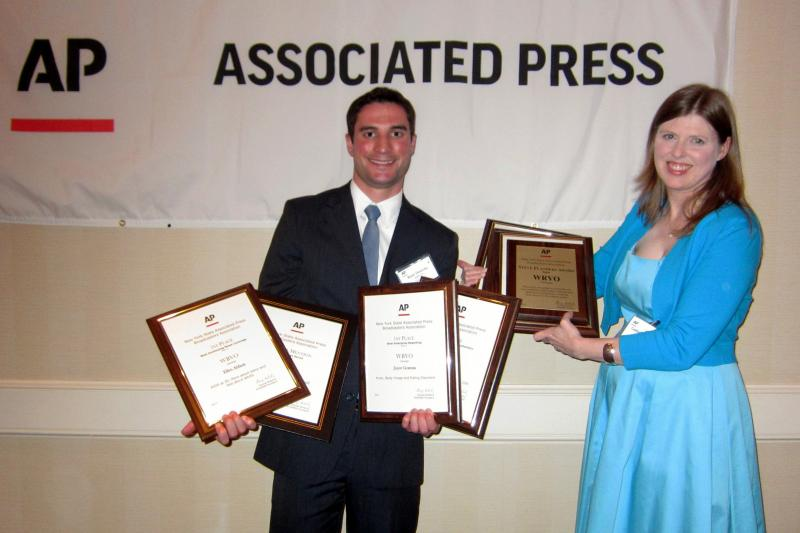 Ryan Delaney, left, and Catherine Loper accept awards from the New York State Associated Press Broadcasters Association.