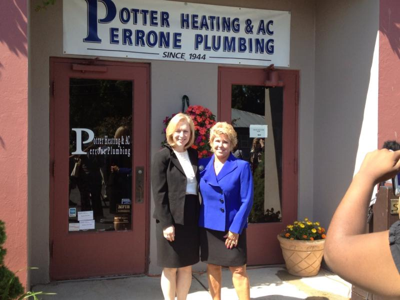 Sen. Kirsten Gillibrand and Suzanne Kondra-DeFuria outside of Potter's Heating and Plumbing this afternoon.