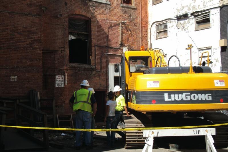 Crews prepare to demolish part of the Bond Building in downtown Syracuse.