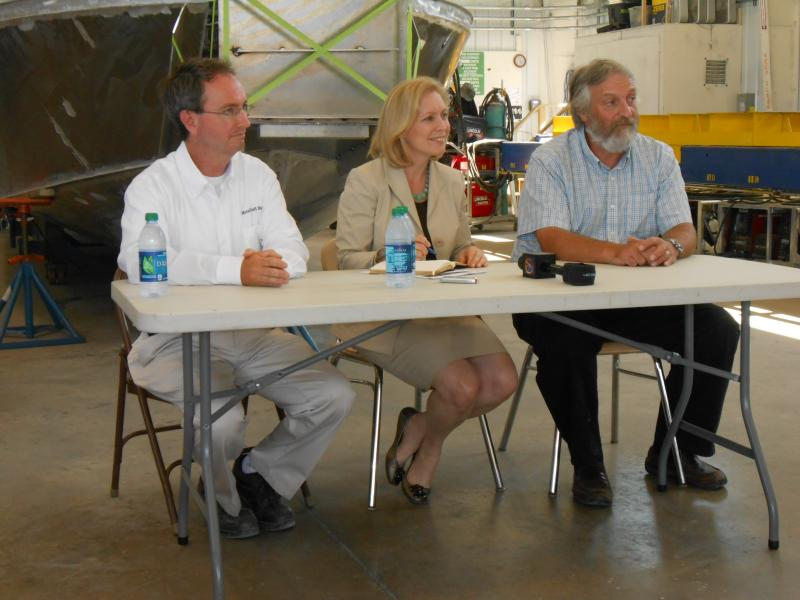 Sen. Kirsten Gillibrand is flanked by MetalCraft Marine officials Thursday in Cape Vincent.