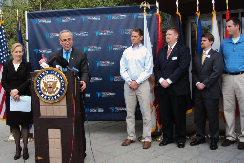 Sens. Kirsten Gillibrand and Charles Schumer (D - N.Y.) stand with a group of veterans in 2012.