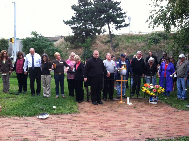 Community members in Syracuse attend the memorial service for Michelle Noce, a homeless woman who lived in the area.