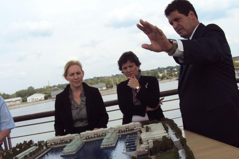 Sen. Kirsten Gillibrand (D-NY), left, and Syracuse Mayor Stephanie Miner listen to developer Steve Aiello explain his plans for the Inner Harbor.