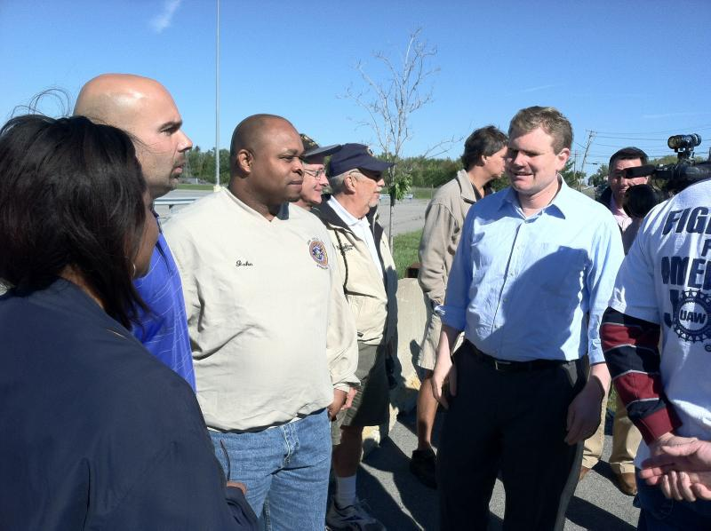 Democrat candidate for Congress Dan Maffei outside the former New Process Gear factory in East Syracuse with former plant workers.