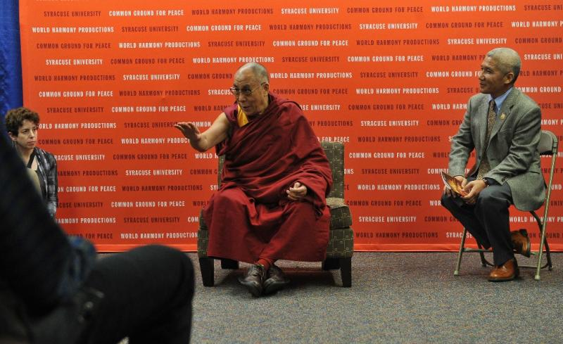 The Dalai Lama answers questions Tuesday before the One World Concert in Syracuse.