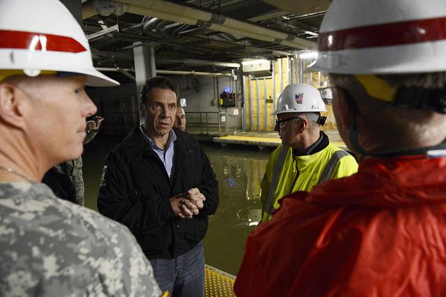 Governor Andrew Cuomo accesses water levels in Path Train Station at World Trade Center site and Brooklyn Battery Tunnel yesterday.