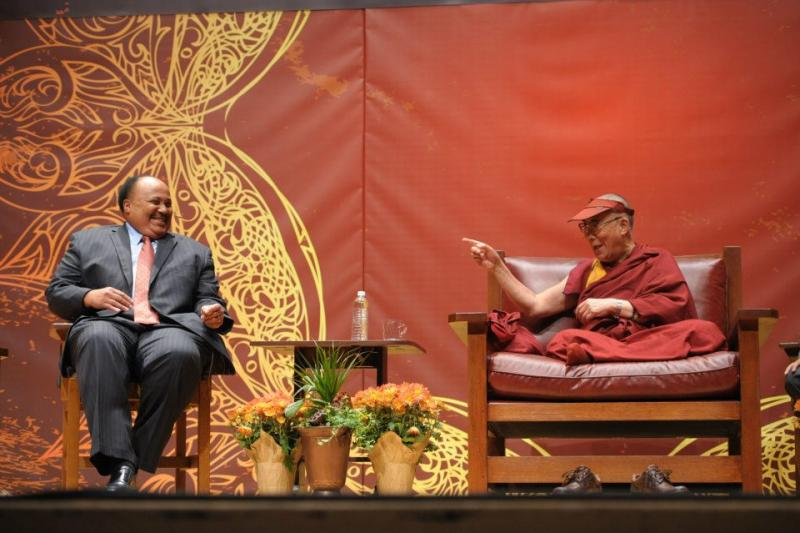 The 14th Dalai Lama, right, jokes with Martin Luther King III during the second Common Ground for Peace discussion Monday.