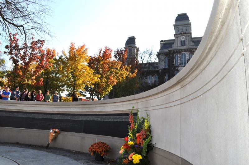 An updated memorial to the victims stands in front of Syracuse University.