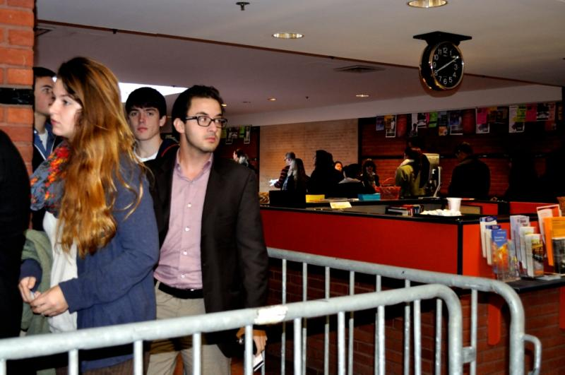 Students line up at Syracuse University's Schine Student Center to see a panel discussion with the Dalai Lama.