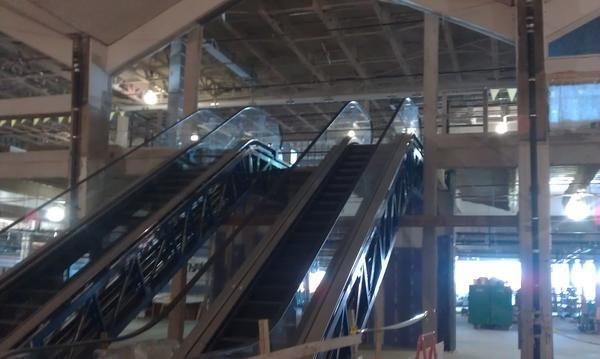 Escalators lead up to the second-floor security area in the new extension of Syracuse's Hancock International Airport.