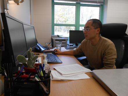 Professor Lei Wu works in his office at Clarkson University.