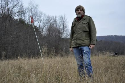 Cornell researcher Brian Richards stands in a switch grass field that's part of NEWBio project.