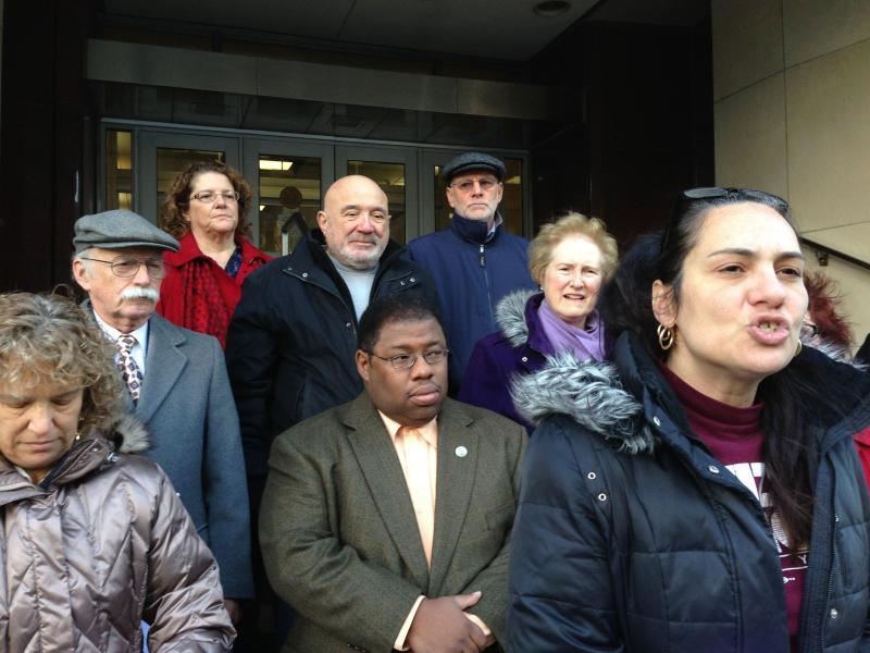 Activists outside state Sen. Dave Valesky's office