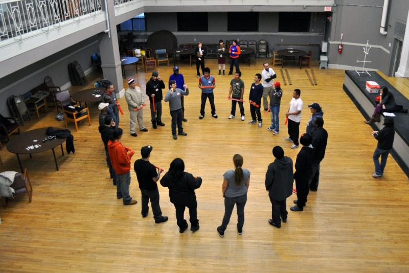 Andy Erickson (in circle) gives instructions for a team-building exercise at a worker training program on Syracuse's North Side.