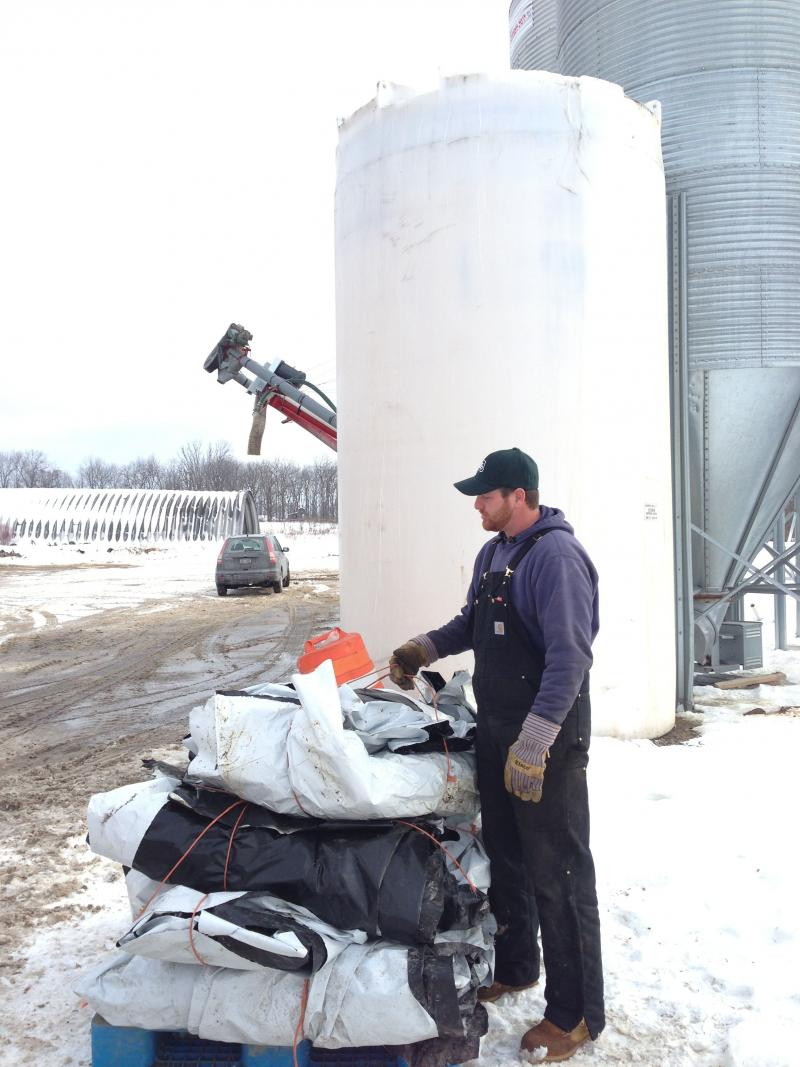 Rich Carrier with plastics to be recycled on his family farm in Madison County