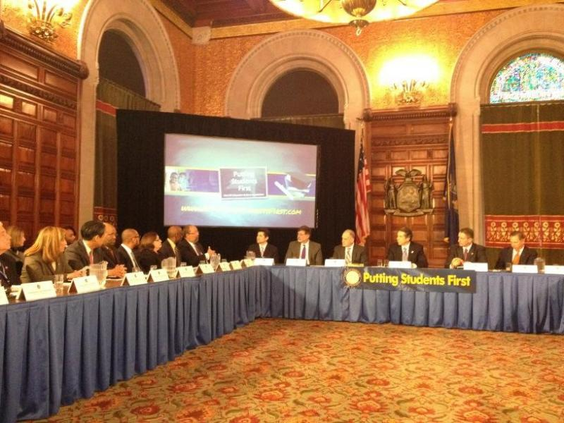 Education commission chairman Dick Parsons presents recommendations to Governor Andrew Cuomo and his cabinet