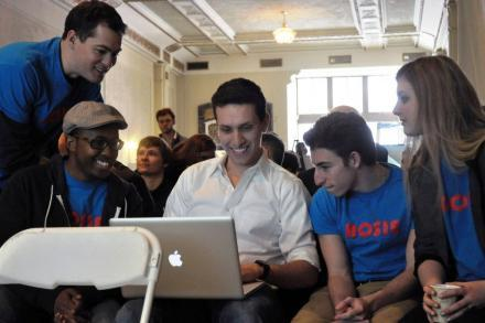 Nick Nickitas, center, CEO of Rosie, goes over his presentation with co-workers.