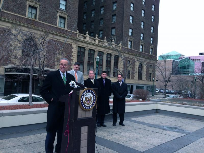 Sen. Charles Schumer (D-NY) speaks in front of the Hotel Syracuse.