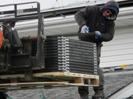 Solar Liberty crew installing solar panels