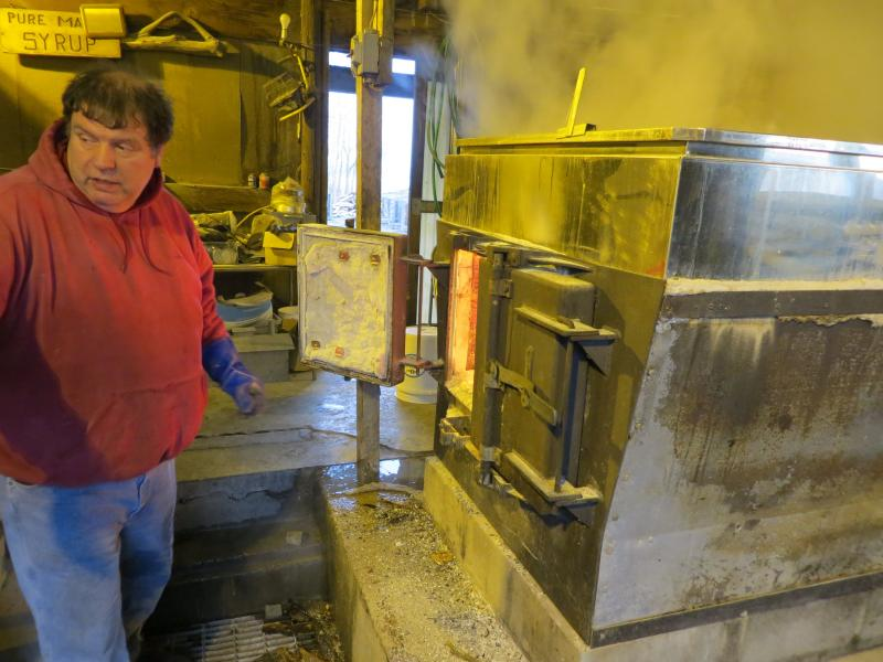 Maple producer Dave Schiek stoking the fire