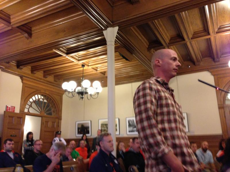 Syracuse firefighter Pete Conover speaks at the budget public hearing Monday evening.