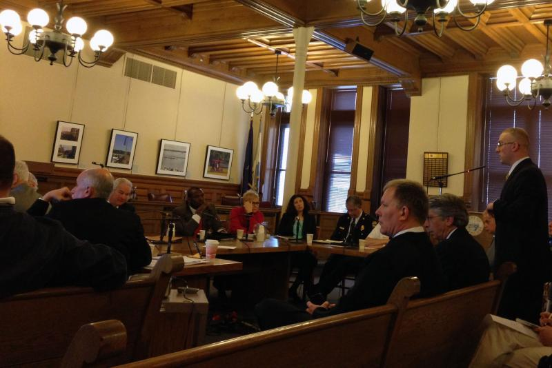 Syracuse firefighter union representative Lonnie Johnson, left, speaks to the Common Council.