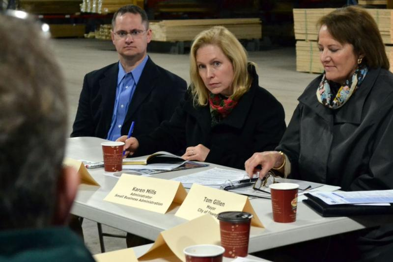 Sen. Kirsten Gillibrand (D-NY), center, listens during a small business forum in Phoenix, N.Y.