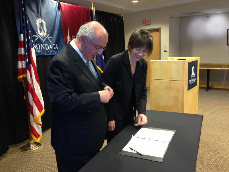 St. John Fisher College President Donald Bain and OCC Interim President Margaret O'Connell sign agreement on joint doctoral program