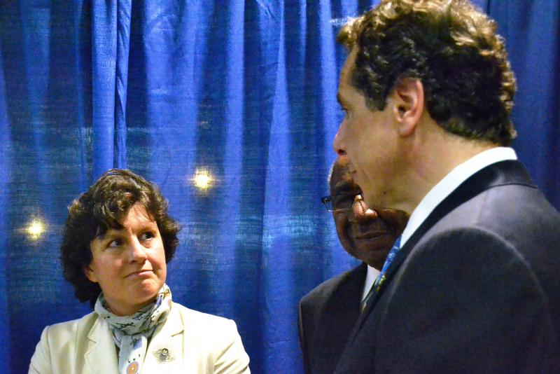Syracuse Mayor Stephanie Miner, left, listens to Gov. Andrew Cuomo during his first visit to Syracuse since October.