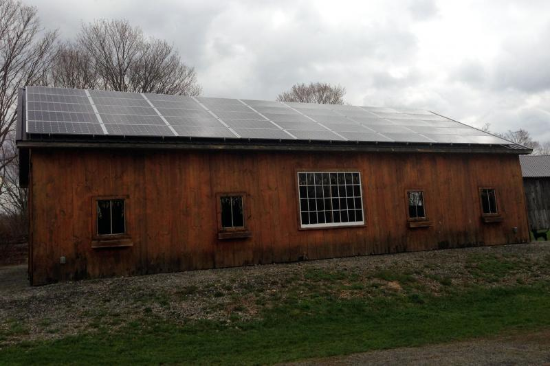 Solar panels cover the roof of Jimmy Golub's barn in Madison County.