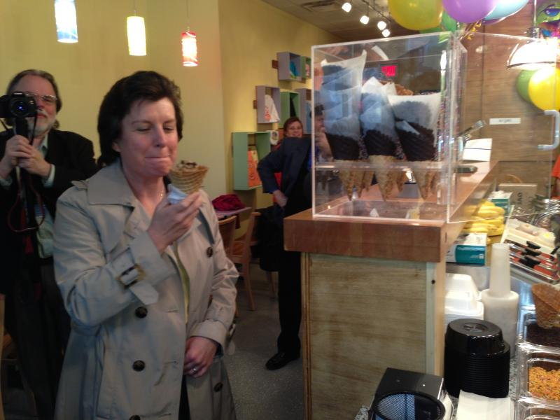 "Syracuse Mayor Stephanie Miner gets the first licks of ""Downtown Turnaround,"" an original oreo-coffe flavored ice cream concoction created by the new Gannon's Isle store downtown."