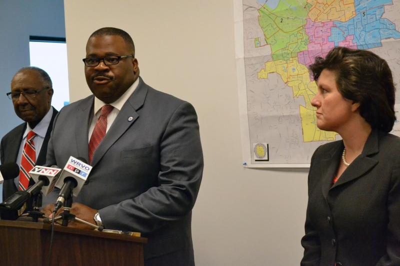 Gary Morris endorses Van Robinson, left, for Syracuse Common Council president as Mayor Stephanie Miner looks on.