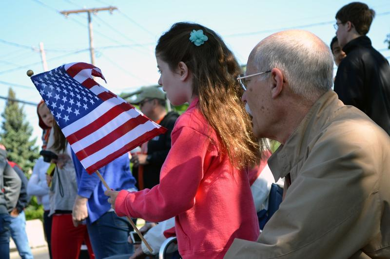 Marek Pierce, 7-years-old, and her grandfather Will Pierce watch the Fayetteville Memorial Day parade.
