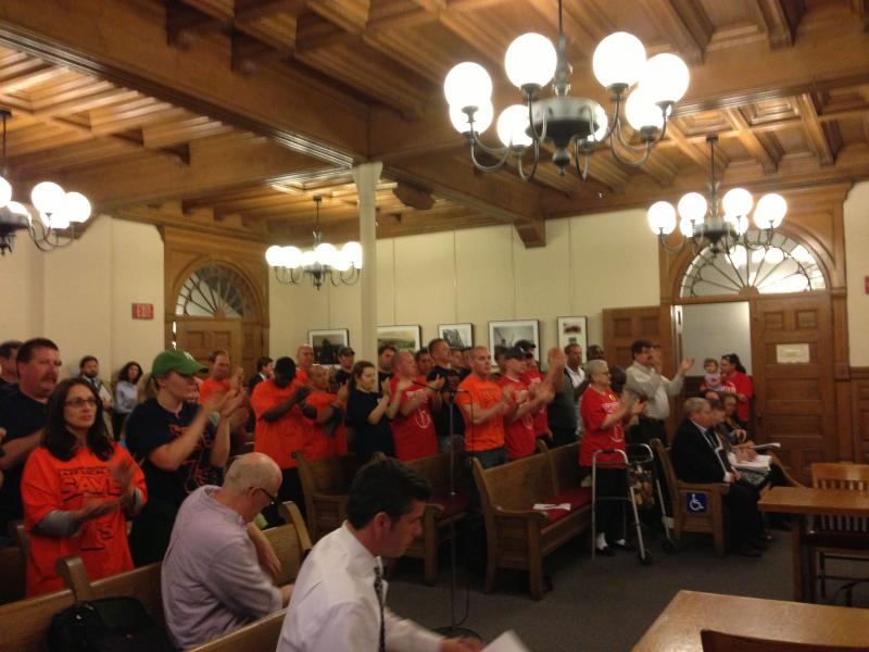 Syracuse Common Council receives a standing ovation after restoring budget cuts to the fire department.