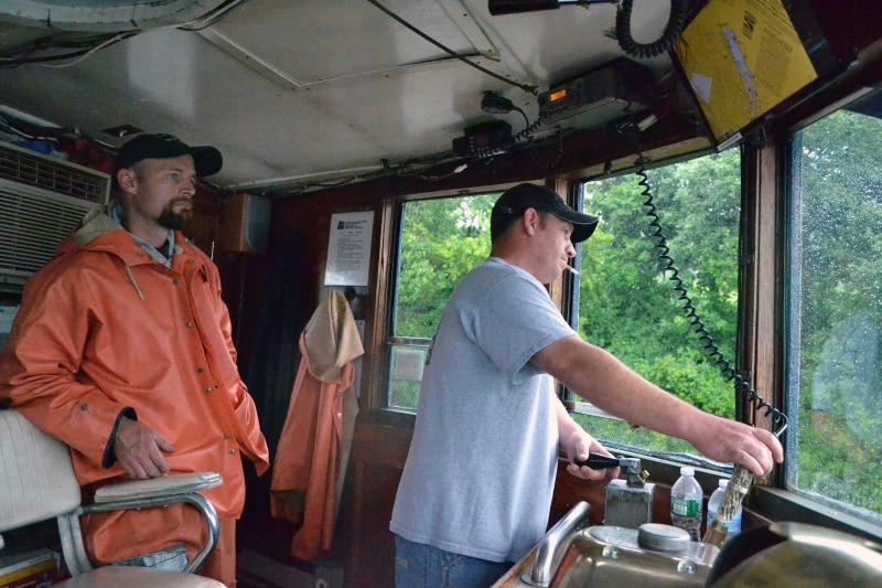 Brad Winchell, left, watches captain Dennis Wasiewski steer the tugboat Margot.