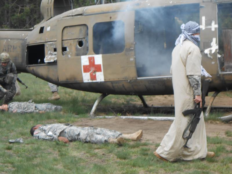 A mass-casualty combat exercise involving a mock helicopter crash tests medics' skills.