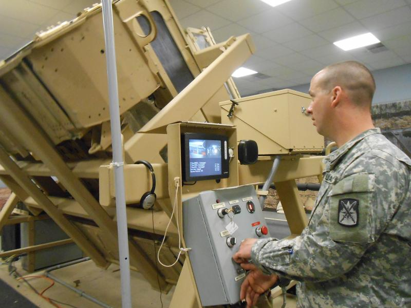 Civilians go for a spin - literally - inside a Humvee rollover simulator.