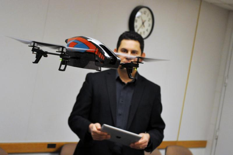 Dan Pacheco, a professor at Syracuse University, demonstrates a small drone equipped with a camera.