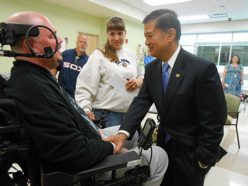 Secretary of Veterans Affairs Eric Shinseki greets a patient at the new Spinal Cord Injury and Disorders Center at the Syracuse VA Medical Center.