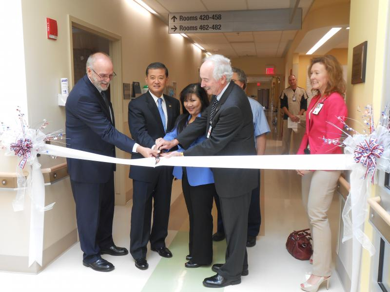 Secretary Shinseki helps hospital officials cut the ribbon symbolizing the grand opening of the new spinal cord wing of the Syracuse VA Medical Center.