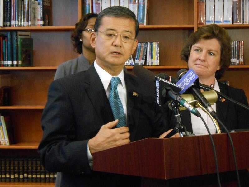 Secretary of Veterans Affairs Eric Shinseki, flanked by Syracuse Mayor Stephanie Miner, speaks to reporters about issues affecting veterans' unemployment in Fowler High School's library, in Syracuse.