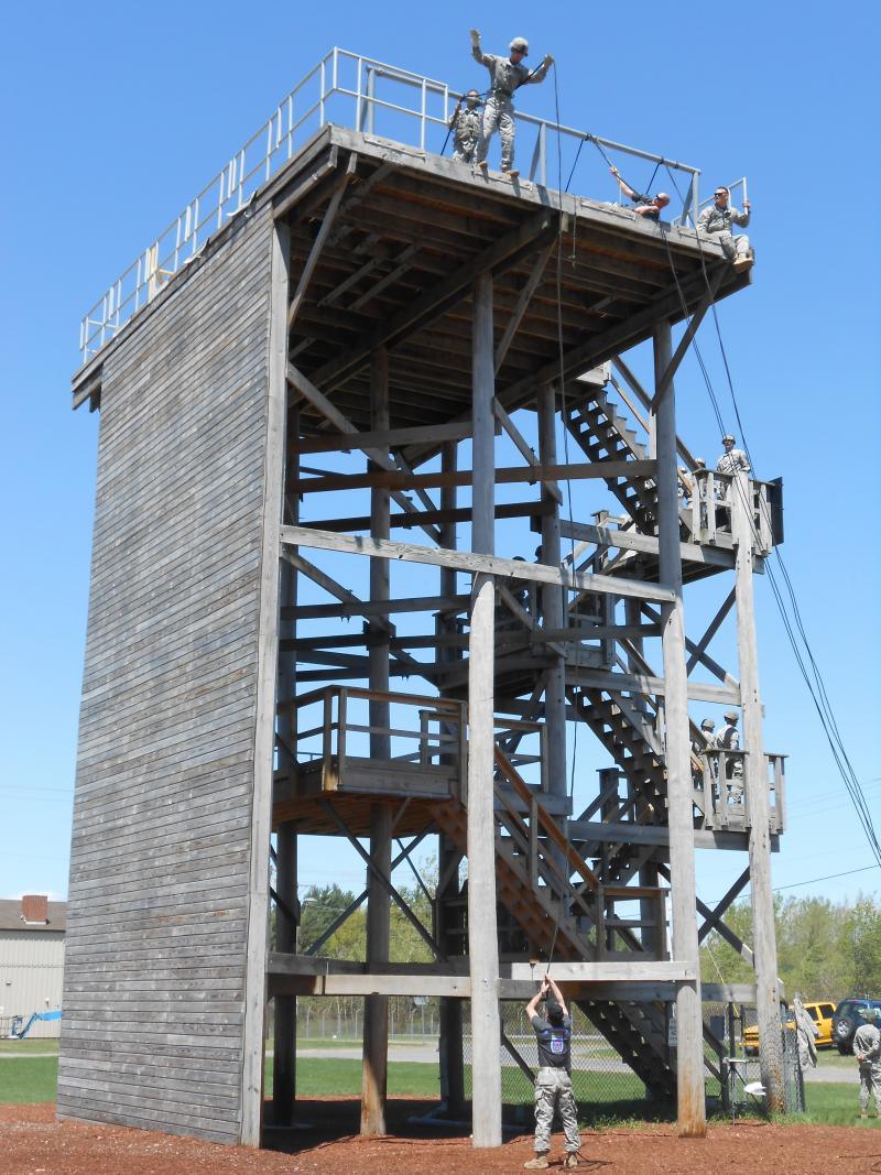 A soldier prepares to rappel head-first off a tower as part of an air assault course that prepares troops to work with helicopters.