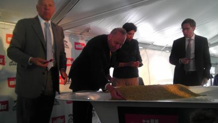 Sen. Schumer joins Pepsi CEO Indra Nooyi and Theo Muller in taking a scoop from a giant Mulle Quaker yogurt tub