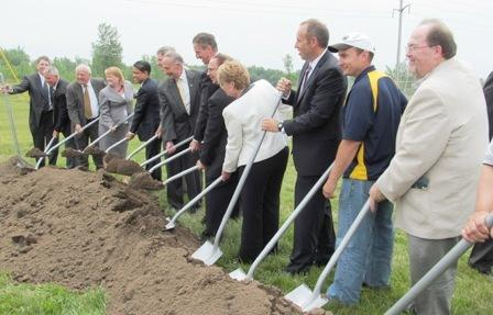Elected officials and Alcoa leaders break ground at the Massena East plant.