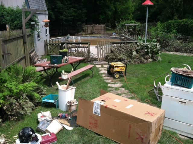 An Oneida man's backyard shows damage to his property from flooding last June.