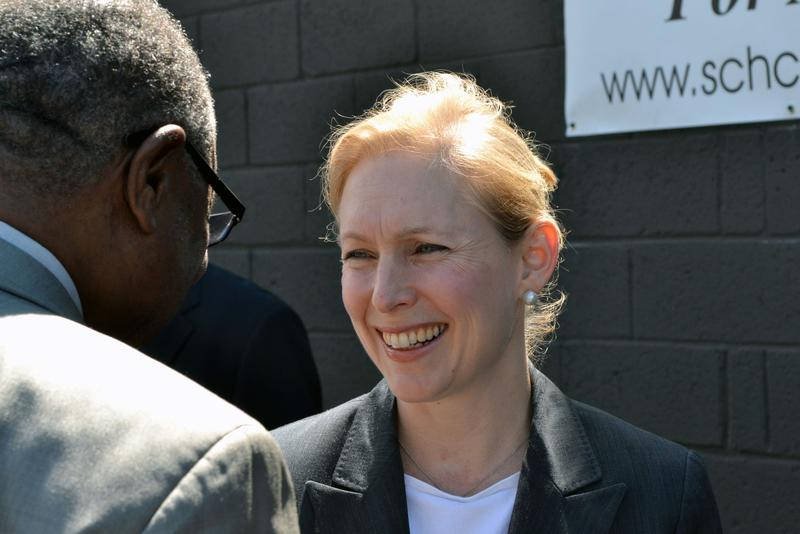 Sen. Kirsten Gillibrand, D-N.Y., talks with Syracuse Common Council President Van Robinson Monday.