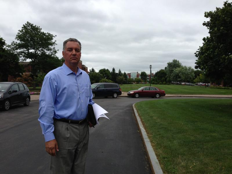 Dean Jim Joseph stands in front of the new Madden School of Business facility that'll open up this semester.